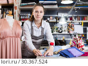 Female seamstress is cutting textile for create new dress. Стоковое фото, фотограф Яков Филимонов / Фотобанк Лори