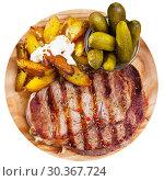 Купить «Appetizing beef entrecote with boiled potatoes and pickled cucumbers», фото № 30367724, снято 19 апреля 2019 г. (c) Яков Филимонов / Фотобанк Лори