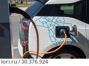Купить «Charging an electric car from DriveNow», фото № 30376924, снято 6 апреля 2018 г. (c) Caro Photoagency / Фотобанк Лори