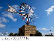 Spain, Mallorca - Windmuehle on a farmland near the village Campos (2016 год). Редакционное фото, агентство Caro Photoagency / Фотобанк Лори