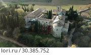 Купить «View from drone of ancient Romanesque monastery Sant Benet de Bagess, Catalonia, Spain», видеоролик № 30385752, снято 24 декабря 2018 г. (c) Яков Филимонов / Фотобанк Лори