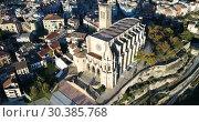 Купить «Aerial view of Manresa town with Basilica de Santa Maria, Catalonia, Spain», видеоролик № 30385768, снято 24 декабря 2018 г. (c) Яков Филимонов / Фотобанк Лори