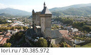Купить «Aerial view of impressive medieval castle on rocky outcrop in French commune of Foix», видеоролик № 30385972, снято 26 октября 2018 г. (c) Яков Филимонов / Фотобанк Лори