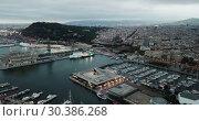 Купить «Night aerial view from drones of old port in Barcelona with of sailboats and yachts and gothic quarter, historical part of the city», видеоролик № 30386268, снято 1 сентября 2018 г. (c) Яков Филимонов / Фотобанк Лори