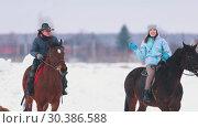 Купить «Three women riding horses in a village with a dog running near by them», видеоролик № 30386588, снято 23 июля 2019 г. (c) Константин Шишкин / Фотобанк Лори