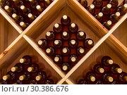 Купить «Stacked bottles of grape wine in a wine cellar», фото № 30386676, снято 9 июня 2018 г. (c) Наталья Волкова / Фотобанк Лори