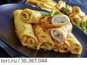 Купить «crepes roll up filled with sweet white cheese», фото № 30387044, снято 6 марта 2019 г. (c) Oksana Zh / Фотобанк Лори