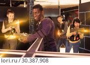 Купить «African man playing laser tag with friends», фото № 30387908, снято 23 января 2019 г. (c) Яков Филимонов / Фотобанк Лори