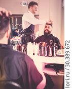 Купить «Hairdresser doing new haircut», фото № 30389672, снято 27 января 2017 г. (c) Яков Филимонов / Фотобанк Лори