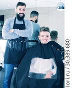Купить «Hairdresser demonstrating his workplace», фото № 30389680, снято 27 января 2017 г. (c) Яков Филимонов / Фотобанк Лори