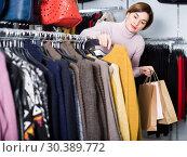 Купить «Customer is deciding on turtleneck sweater», фото № 30389772, снято 7 февраля 2017 г. (c) Яков Филимонов / Фотобанк Лори