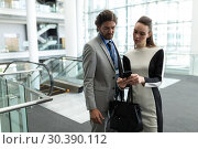 Купить «Caucasian businessman and Caucasian businesswoman discussing over mobile phone near escalator», фото № 30390112, снято 21 ноября 2018 г. (c) Wavebreak Media / Фотобанк Лори