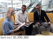Купить «Caucasians business executives interacting with each other on sofa in office», фото № 30390380, снято 21 ноября 2018 г. (c) Wavebreak Media / Фотобанк Лори