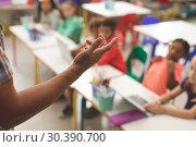 Купить «Close-up of teacher arm against blur school kids sitting on their chair », фото № 30390700, снято 17 ноября 2018 г. (c) Wavebreak Media / Фотобанк Лори