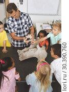 Купить «Teacher explaining and showing animal skeleton to his pupils in classroom», фото № 30390760, снято 17 ноября 2018 г. (c) Wavebreak Media / Фотобанк Лори