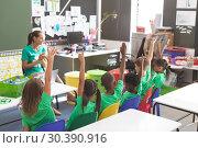 Купить «Teacher discussing about green energy and recycle at desk in classroom», фото № 30390916, снято 17 ноября 2018 г. (c) Wavebreak Media / Фотобанк Лори