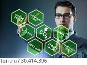 Купить «Businessman in ecology and environment concept», фото № 30414396, снято 25 мая 2020 г. (c) Elnur / Фотобанк Лори