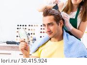 Купить «Woman hairdresser applying dye to man hair», фото № 30415924, снято 5 сентября 2018 г. (c) Elnur / Фотобанк Лори