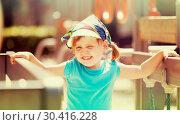 laughing girl at playground area in sunny day. Стоковое фото, фотограф Яков Филимонов / Фотобанк Лори