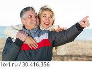 Купить «Mature couple walks outdoors and point by hand», фото № 30416356, снято 22 августа 2019 г. (c) Яков Филимонов / Фотобанк Лори