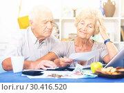 Купить «Frustrated senior couple faced financials troubles», фото № 30416520, снято 28 августа 2017 г. (c) Яков Филимонов / Фотобанк Лори