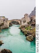 View of Stari Most a 16th-century Ottoman bridge over Neretva river in the city of Mostar in Bosnia Herzegovina (2018 год). Стоковое фото, фотограф Николай Коржов / Фотобанк Лори