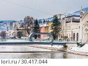 View of Sarajevo and Festina Lente bridge over river Miljacka,Bosnia and Herzegovina (2018 год). Редакционное фото, фотограф Николай Коржов / Фотобанк Лори