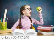 Pretty Caucasian Primary Student Girl Study Home. Стоковое фото, фотограф Иван Карпов / Фотобанк Лори