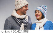 Купить «happy couple in winter wear looking at each other», видеоролик № 30424908, снято 24 марта 2019 г. (c) Syda Productions / Фотобанк Лори