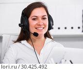 Купить «Woman working at call-center», фото № 30425492, снято 22 марта 2017 г. (c) Яков Филимонов / Фотобанк Лори