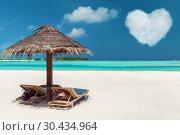 Купить «two sunbeds under palapa on maldives beach», фото № 30434964, снято 12 февраля 2016 г. (c) Syda Productions / Фотобанк Лори