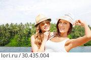 Купить «teenage girls over infinity edge pool in sri lanka», фото № 30435004, снято 11 июля 2013 г. (c) Syda Productions / Фотобанк Лори