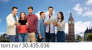 Купить «group of friends with tablet computers over london», фото № 30435036, снято 10 ноября 2018 г. (c) Syda Productions / Фотобанк Лори