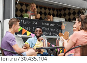 Купить «happy friends with drinks eating at food truck», фото № 30435104, снято 1 августа 2017 г. (c) Syda Productions / Фотобанк Лори