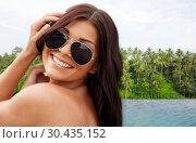 Купить «happy woman over infinity edge pool in sri lanka», фото № 30435152, снято 6 августа 2015 г. (c) Syda Productions / Фотобанк Лори