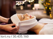 Купить «woman having face massage with towel at spa», фото № 30435160, снято 26 января 2017 г. (c) Syda Productions / Фотобанк Лори