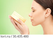 Купить «beautiful woman smelling moisturizing cream aroma», фото № 30435480, снято 2 апреля 2011 г. (c) Syda Productions / Фотобанк Лори
