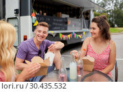Купить «happy friends with drinks eating at food truck», фото № 30435532, снято 1 августа 2017 г. (c) Syda Productions / Фотобанк Лори