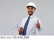 Купить «architect or businessman in helmet shows thumbs up», фото № 30435848, снято 12 января 2019 г. (c) Syda Productions / Фотобанк Лори
