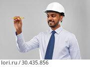 Купить «indian architect or businessman in helmet», фото № 30435856, снято 12 января 2019 г. (c) Syda Productions / Фотобанк Лори
