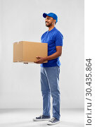 Купить «happy indian delivery man with parcel box in blue», фото № 30435864, снято 12 января 2019 г. (c) Syda Productions / Фотобанк Лори
