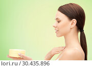 Купить «beautiful woman with moisturizing cream», фото № 30435896, снято 2 апреля 2011 г. (c) Syda Productions / Фотобанк Лори