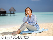 Купить «happy woman over tropical beach and bungalow», фото № 30435920, снято 15 июня 2018 г. (c) Syda Productions / Фотобанк Лори