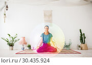 Купить «woman meditating in lotus pose at yoga studio», фото № 30435924, снято 21 июня 2018 г. (c) Syda Productions / Фотобанк Лори