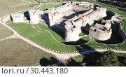 Купить «Aerial view of impressive medieval Catalan Fort de Salses in French commune of Salses-le-Chateau», видеоролик № 30443180, снято 3 января 2019 г. (c) Яков Филимонов / Фотобанк Лори