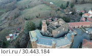 Купить «Aerial view of impressive medieval castle of Chateau de Bouzols on hill in commune of Arsac-en-Velay, France», видеоролик № 30443184, снято 29 января 2019 г. (c) Яков Филимонов / Фотобанк Лори