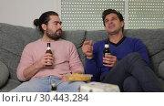 Купить «Two men friends are talking and drinking beer», видеоролик № 30443284, снято 13 марта 2019 г. (c) Яков Филимонов / Фотобанк Лори