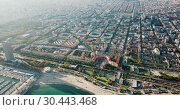 Купить «Aerial view of seaside area of Barcelona with harbor on sunny day, Catalonia, Spain», видеоролик № 30443468, снято 3 ноября 2018 г. (c) Яков Филимонов / Фотобанк Лори