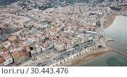 Купить «View from drone of famous tourist town of Roses on Catalan coast of Gulf of Roses, Costa Brava, Spain», видеоролик № 30443476, снято 10 февраля 2019 г. (c) Яков Филимонов / Фотобанк Лори