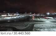 MOSCOW, RUSSIA - 25 december 2017: Night panoramic view of Terminal A of Vnukovo International Airport and airport building with teletraps and apron with airplanes. Стоковое видео, видеограф Mikhail Starodubov / Фотобанк Лори